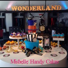 2nd birthday cake for Liberte this past week! Fun Mad Hatter theme ! Darling shop ! www.mishellehandycakes.com