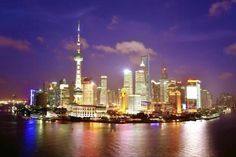 Shanghai: The Bund and Huangpu River check out more Top 10 Best Attractions To Explore In Different Cities Of China http://www.ourlovefortravel.com/2014/03/18/top-10-best-attractions-explore-different-cities-china/