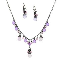 """Featuring a combination of light and dark amethyst colored beads on a 16"""" adjustable jet-toned chain. Matching beaded drop earrings included. Makes a great gift."""