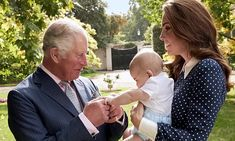 Proudly laughing at his new grandson, Prince Louis, a never-before-seen picture shows Prince Charles as a doting grandparent as he was also seen spinning Camilla's granddaughter.