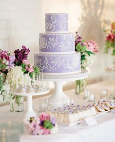 Color counts when designing a spring wedding cake, and you can't go wrong with a palette of preppy white, pink, and lime green or a pastel hue like lavender. l TheKnot.com