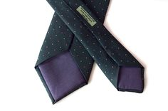 DOTS AND SPOTS - This classic dot and spot tie features a playfully scattered array of pink and green dots. Set on a dark purple background, this colour stimulates the imagination and inspires high ideals