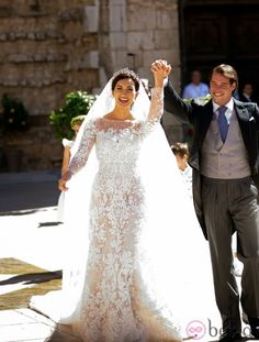 Pretty dress....assume that it's not really see-thru but nude fabric under the lace?...Princess Claire and Prince Felix of Luxembourg on the religious wedding day 9/21/2013