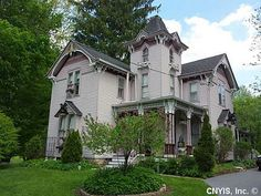 This Victorian beauty sits on Main Street in Schroeppel, New York (about 30 minutes north of Syracuse) and even has a leather trimmed library and stained glass windows.