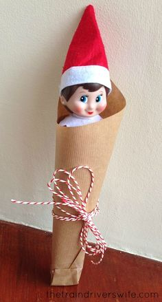 "Elf on the Shelf Ideas ""Brown Paper Packages, tied up with string. These are a few of my favourite things!"" Ninnin has wrapped herself up as a morning surprise for Buddy!"