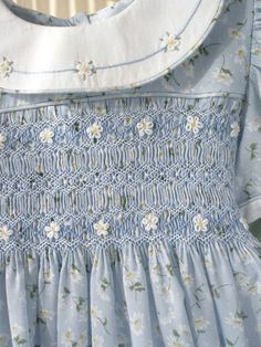 grandma was a seamstress and made my dresses, She smocked beautifully like this little dress.. I  <3  you gramma