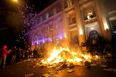 Anti-government protesters burn documents near the public prosecution office after an attempt to take it over in the town of Ternopil in western Ukraine, February 19, 2014.