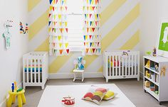 Bright nursery - love the stripes on the wall.
