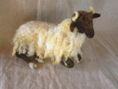 I love this needle felted sheep!