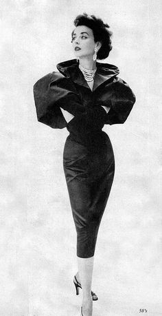 Dorian Leigh wearing a satin and taffetas dress and jacket by Howard Greer, 1951