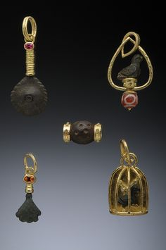 Assorted Bronze Antiquity Pendants in 18k with details of White Diamonds, Red Spniel, Orange Garnet and Burmese Pyu Bead Hughes-Bosca Jewelry | Pendants & Brooches