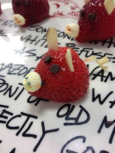 Razorback Strawberries! You'll need:  Strawberries, Mini marshmallows, Semi-sweet chocolate chips, Almond slices, Raman noodles & Toothpicks.  To make: Cut the bottom off of the strawberries. Pull the stems off. Use almond slices for the ears. Use semi-sweet morsels for the eyes. Use toothpicks to poke two holes in the mini marshmallow for the snout. Use a raman noodle for the tail. WOO PIG SOOIE!!!
