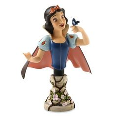 "Enesco 2011  Disney Showcase Collection  SNOW WHITE BUST    Seven decades after her big-screen debut, Snow White is still the ""fairest one of all."" Now Walt Disney's beloved princess is immortalized in all her timeless beauty and charm.    Materials: Stone Resin  Size: 6.75""H x 5""W x 5.25""L  LE1000    Your Price: $65.00"