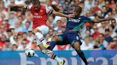Arsenal forward Lukas #Podolski vies with Fraizer #Campbell of Sunderland