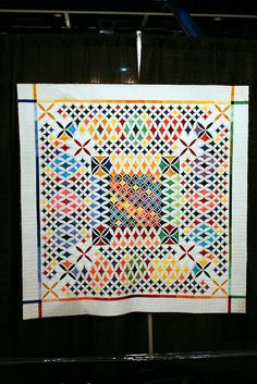 I know the cathedral window technique but this takes it to a whole new level. Cathedral Window Quilts, Cathedral Windows, Rainbow Quilt, Miniature Quilts, Quilt Festival, Quilting Designs, Quilting Ideas, Crafty Craft, Pattern Making