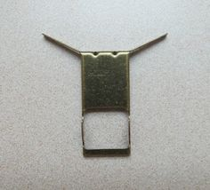 Hang Items On Brick Without Drilling/brick clip found at most home improvement centers