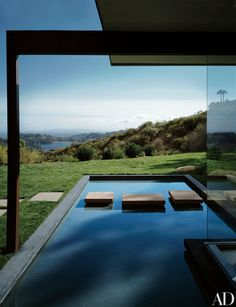 Ronnie and Vidal Sassoon renovated the Singleton House, built by architect Richard Neutra in 1959; this photograph replicates a classic image of the property by Julius Shulman.