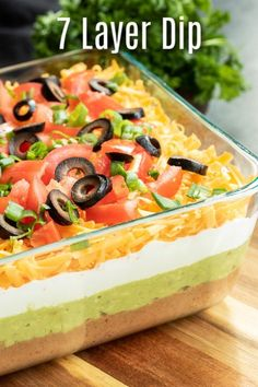 This easy Mexican 7 Layer Dip is the perfect dip recipe for a crowd! This game d. This easy Mexican 7 Layer Dip is the perfect dip recipe for a crowd! This game day dip can be made 7 Layer Taco Dip, 7 Layer Dip Recipe, Seven Layer Dip, 7 Layer Mexican Dip, Mexican Bean Dip, 7 Layer Bean Dip, Mexican Dip Recipes, Bean Dip Recipes, Mexican Dishes