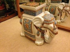 China elephant ornament plant stand Decorative elephant pot stand. White green blue and brown. Mug on the last picture or not included but is shown to provide visual idea of size. Approx 40cm wide. 40cm high. 20cm deep. Hollow middle. Very good condition. From pet and smoking free...