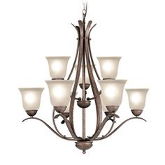 @Overstock - Fixture finish: Marbled bronze  Shades: Frosted seedy glass   Requires nine (9) 60-watt max medium base bulbs (not included) http://www.overstock.com/Home-Garden/Woodbridge-Lighting-Beaconsfield-9-light-Marbled-Bronze-Chandelier/6265289/product.html?CID=214117 $364.99