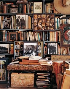 Old photographs with messy books is a lovely bookshelf idea.