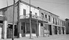 """Tombstone, Arizona in decay: ruins of the """"Gird Block,"""" which once housed the offices of the Tombstone Epitaph newspaper and the Mining Exchange Building (where Wyatt Earp, his brothers, and Doc Holliday stood trial in November 1881), photographed in 1937 by Frank D. Nichols. All the buildings in this block of Fremont Street disappeared in the 1940s. This block is now a parking lot for O.K. Corral visitors."""
