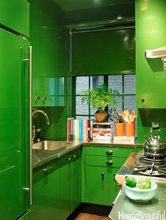 """In a small New York City kitchen, Miles Redd saturated the space in emerald green. """"In a small space, I like to take one color and use it everywhere,"""" he says. """"There's something refreshing about emerald green. It puts a modern spin on a tiny Manhattan kitchen and feels cool and sparkling, especially in this glassy finish. Kind of like a gin and tonic."""""""