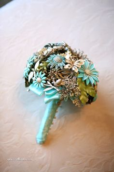 vintage brooch bridal bouquet in turquoise and cream...Wedding at Wildwood Inn  www.Denton-WildwoodInn.com #broochbouquet #vintagewedding #bridalbouquet