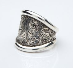 Sterling Silver hand engraved Cigar Band ring. $250.00, via Etsy.