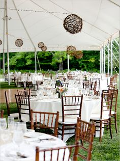 Rustic interior of wedding reception tent (I would add white paper lanterns along with the twig ones).