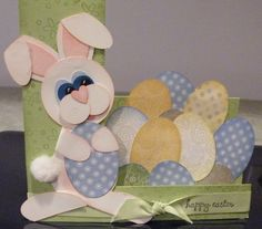 Sweet Happy Easter Card...with bunny and cut out eggs.  I have to keep in mind that a step card doesn't have to be a scene with appropriately sized trees, flowers, etc. it can be simple and sweet.