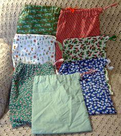 FABRIC REUSABLE Christmas gift bags.