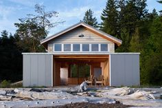 Set along the rugged shore of northern Washington, the Hood Canal Boathouse transforms a lifeless shed into a charming waterfront retreat. The former windowless structure is now clothed in a concrete and steel facade. A set of sliding barn doors...