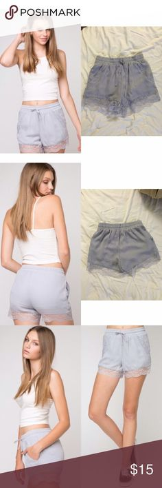 "NWT Brandy Melville Dorothy Lavender Shorts NWT Brandy Melville Dorothy Lavender Shorts »→ osfm »→ best on xs-s »→ polyester »→ 12"" length »→ 11"" waist but has stretch »→ elastic waistband with drawstring shorts »→ Delicate lace trimming on side pockets and hemline »→ silky polyester lining »→ nwt, never worn Brandy Melville Shorts"