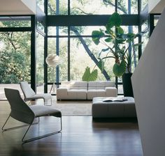 The palette of the entire home has been kept bright and neutral to allow the natural setting to set the hues, like living artwork inside the expanse of black window frames that span the length of the walls.