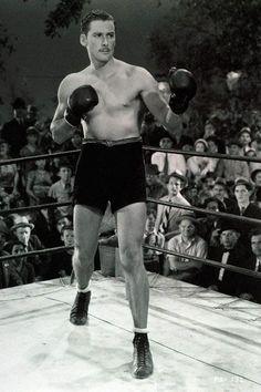 "Errol Flynn portrays boxer ""Gentleman Jim"" Corbett in 1942 film. Flynn had experience as a boxer in Australia."