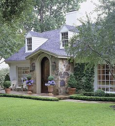 European Cottage Cape Cod  A reconfigured arched entryway and new flagstone facade adorned with climbing vines give this Cape Cod-style home a European cottage spin.