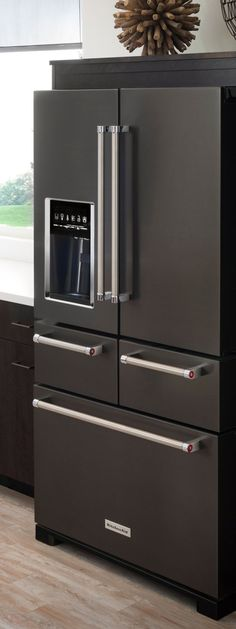 Black stainless steel appliances give your kitchen a bold, sleek look. KitchenAid's refrigerator has the cool factor, plus its configuration offers simplified food storage and access. - My Home Decor Stainless Steel Appliances, Black Stainless Steel, Home Appliances, Black Appliances, Kitchen Pantries, Stainless Steel Kitchen Appliances, Stainless Steel Refrigerator, Kitchen Cabinets, Deco Design
