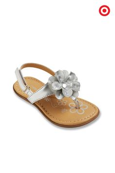 Your little girl will adore the way these Cherokee Jess sandals make every outfit extra special, from tees and shorts to summer dresses. Topped with a pretty flower, these metallic sandals are on-trend and fun. Plus, the straps have easy hook-and-loop adjustable fasteners for little fingers.