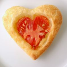 Tomato Tarts! Woot. Yummy zesty Valentines Day appetizer or lunch bites. I can imagine these also made with mozzarella cheese and Italian seasoning for a pizza bite or american cheese and butter for a grilled cheese and tomato flavor.