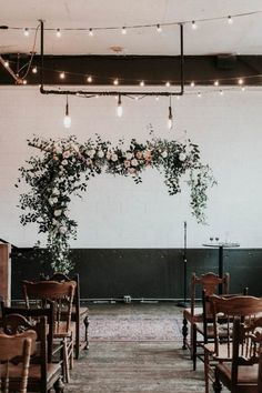 Playing with symmetry adds an edgy touch to your wedding, from your florals to ceremony arch   image by Karra Leigh