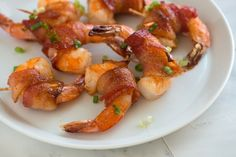 Spicy Maple Bacon Wrapped Shrimp Recipe from www.inspiredtaste.net #recipe #shrimp