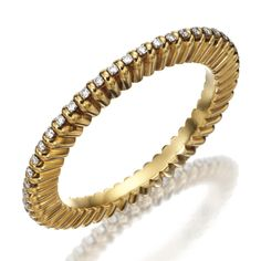 18K GOLD AND DIAMOND BANGLE-BRACELET, CARTIER, PARIS. Round diamonds weighing approximately 6.25 carats, gross weight approximately 44 dwts., internal circumference 8 inches, signed Cartier, Paris, partial maker's mark, partial French assay mark.