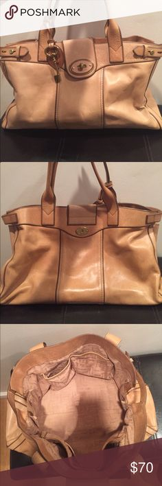 Fossil large shoulder bag Gorgeous real leather bag from fossil. Perfect tan color that matches everything. Spacious bag with many pockets including a zipper pocket. Moderate wear of wear but not deformities, scratches or broken pieces. Fossil tag with key attached. Great for everyday use and travel Fossil Bags Shoulder Bags