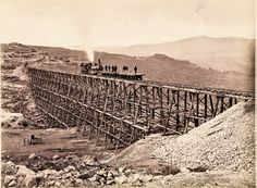 During 1868-69, Andrew J. Russell's camera recorded the Union Pacific's progress toward Promontory Summit, the Utah site where the Central and Union Pacific Railroads joined on May 10, 1869, officially bringing the East and the West Coasts together via rail. Capturing this 450-foot-wide wooden trestle on the Union Pacific line east of Promontory, Russell shows U.P. crews standing on two flatbeds being pushed by Engine No. 119.