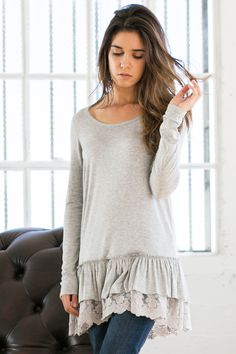 Ruffled Long Sleeve Top Long sleeve top in Ivory (gray is currently sold out). Lace layered ruffle on bottom hem line. Perfect for  layering OR wearing stand along.  True to size.