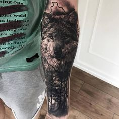 Black and grey wolf and nature tattoo by Mark 'TheShark' of Sinners Ink
