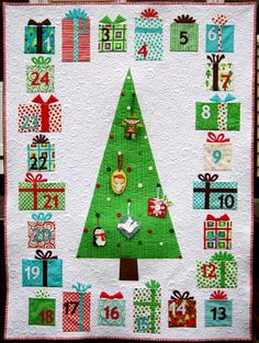 Advent Tree Calendar Quilt.  Each gift is a pocket which hold a little flat ornament to hang on the buttons on the tree.