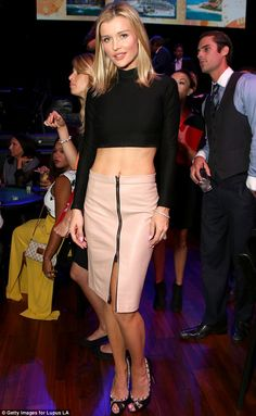 Slim and sweet: Joanna Krupa flashed her midsection in a black crop top - recalling a Nineties Britney Spears - as she stopped by the Get Lucky For Lupus event in Hollywood on Wednesday