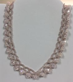 Powder pink beaded necklace by Maxine.
